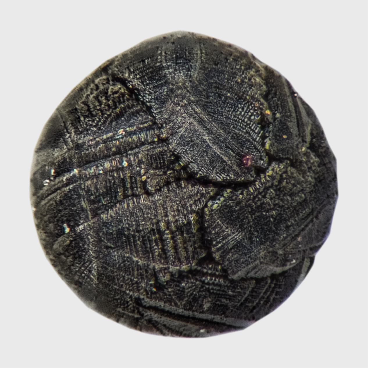 Irdische Sphärulen – Imitatoren der Mikrometeoriten